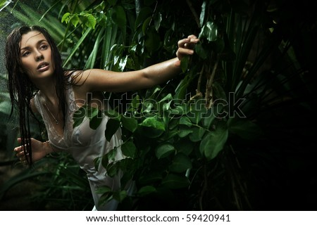 Sexy young brunette beauty in a rain forest - stock photo
