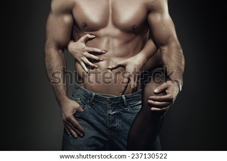 Sexy young couple body at night, woman embrace man abs - stock photo