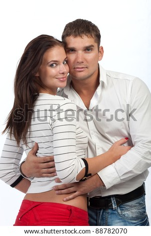 Sexy young couple hug isolated on white studio background