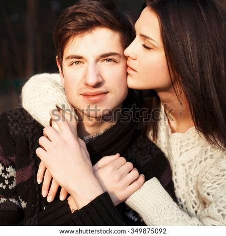 Sexy young couple in love posing outdoor in winter cold weather  - stock photo