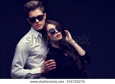 Sexy young couple in love. Studio shot on dark background - stock photo