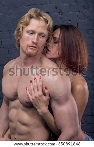 Sexy young couple. Man and woman holding hands. Close up. Young couple in love. Photo for cover of a book about love, sex, passion, jealousy and betrayal. Temptation. Modern love.