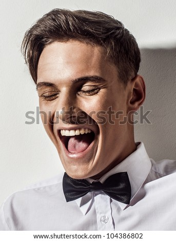 Sexy young elegant man smile - stock photo