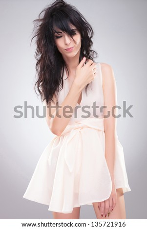 sexy young fashion woman posing with her eyes shut. on gray background - stock photo