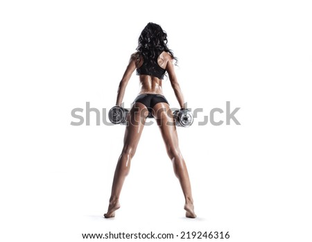 sexy young fitness girl doing workout with dumbbells isolated over white. Fitness woman in sport wear with perfect fitness body workout  back view - stock photo