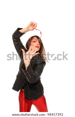 sexy young girl dancing while she holds a red strip