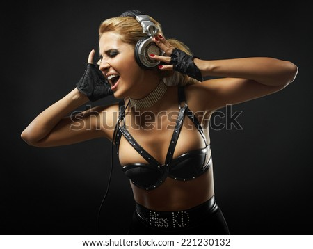 Sexy young girl posing on black background - stock photo