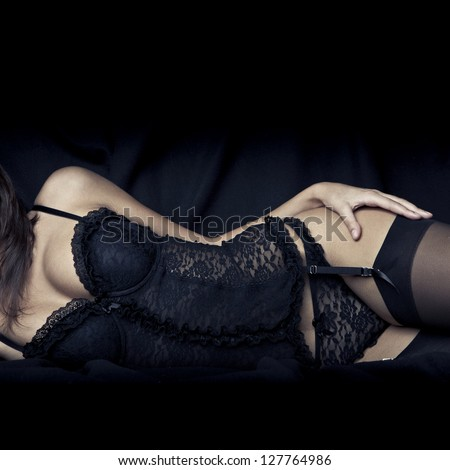 sexy young girl with big breasts in black lingerie - stock photo