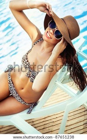 Sexy young lady at swimming pool - stock photo