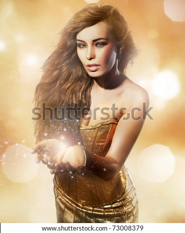 Sexy young lady showing your shining object - stock photo