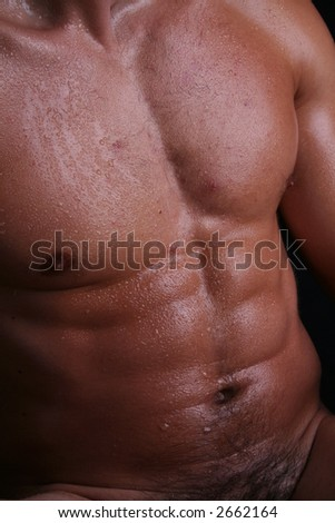 Sexy young male with beautiful abs - stock photo