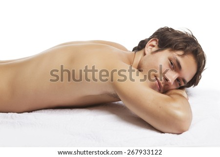 Sexy young man relaxing in spa, isolated on white - stock photo