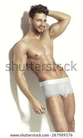 Sexy young men in boxer shorts - stock photo