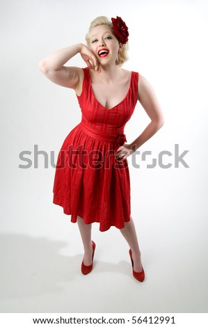 sexy young pinup girl in red dress