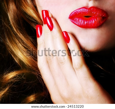Sexy young pretty woman / model / girl / student / businesswoman / secretary with pink lips, vintage / retro is sending a kiss / smooch / red lips / seductive - closeup - stock photo