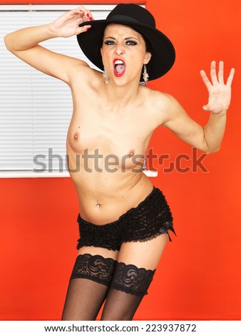 Sexy Young Topless Woman Posing in Black Stocking - stock photo