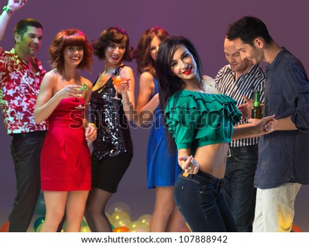 sexy, young woman dancing on the dancefloor, in a night club - stock photo