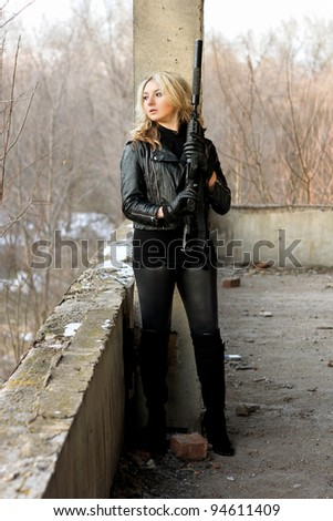 Sexy young woman hiding because of dangerous situation - stock photo