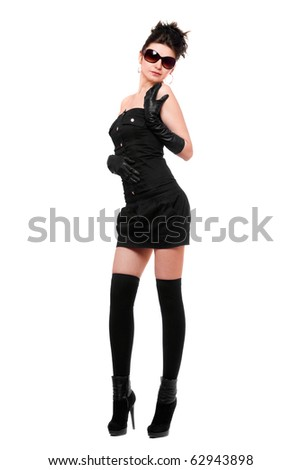 Sexy young woman in a black dress. Isolated on white - stock photo