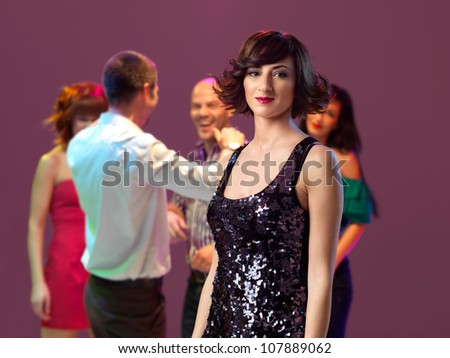 sexy, young woman in a night club - stock photo