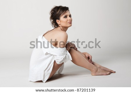 Sexy, young woman in a white shirt - stock photo