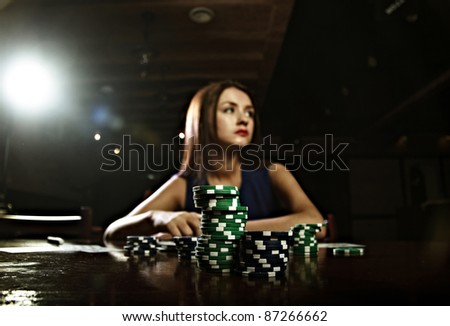 Sexy young woman in casino - stock photo