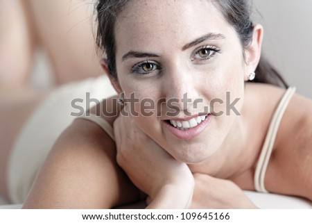 Sexy young woman in cream underwear - stock photo