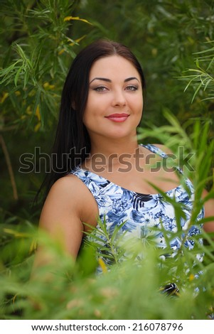 sexy young woman in dress in the grass