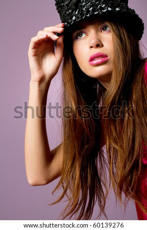 Sexy young woman in fashionable hat - stock photo