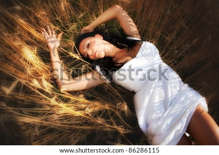 Sexy young woman in grain field - stock photo