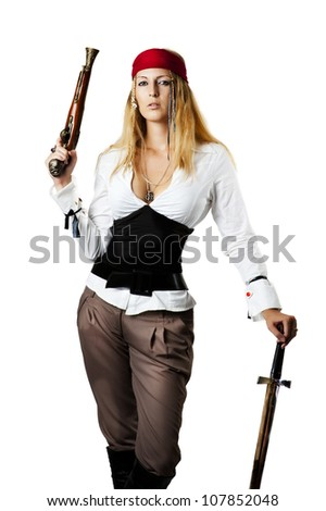 Sexy young woman pirate on the schooner holding a flintlock pistil and medieval sword in a pirates outfit