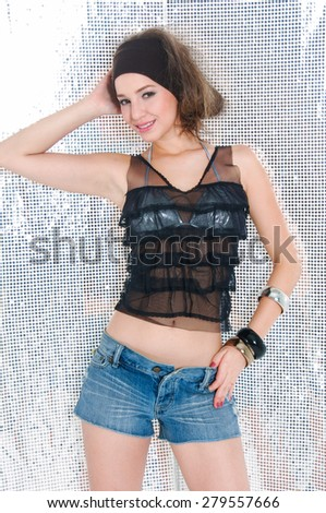 Sexy young woman posing in blue shorts jeans - stock photo