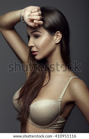 sexy young woman posing in the studio, sensual