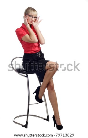 sexy young woman sitting on chair in skirt  isolated on white background - stock photo
