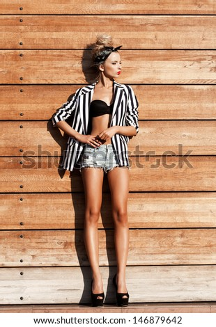 Sexy young woman wearing shorts. Lifestyle, outdoors - stock photo