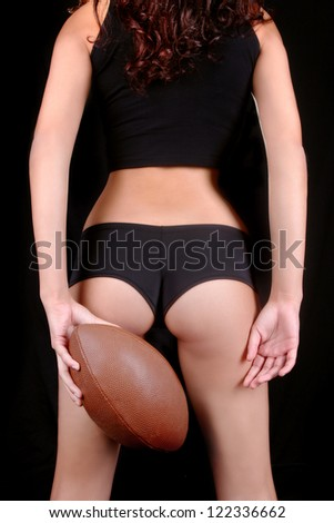 Sexy Young Woman With a Football
