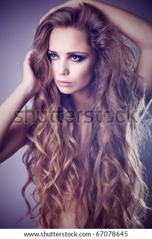 Sexy young woman with beautiful long hair - stock photo