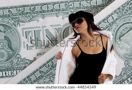 Sexy young woman with dollar bills in the background