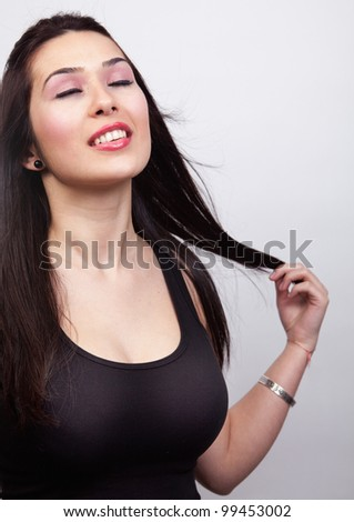 Sexy young woman with long dark hair