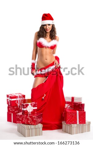 Sexy young woman with lot of presets and big red bag - stock photo