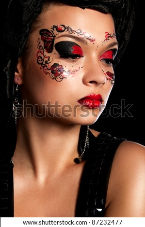 sexy young woman with mask on fa?e and magnificent red lips - stock photo