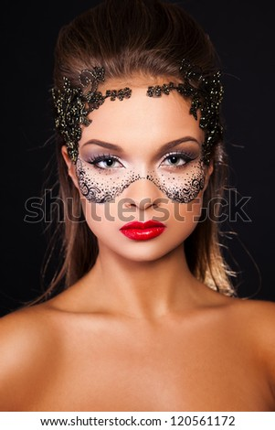 sexy young woman with mask on face