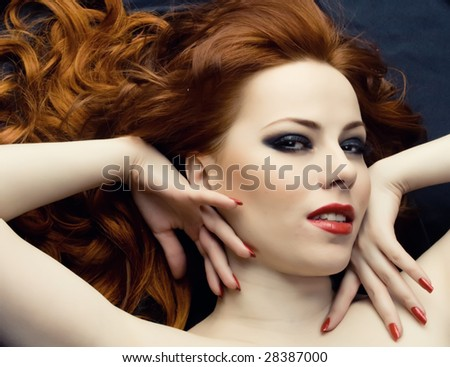 Sexy young woman with red hair - stock photo