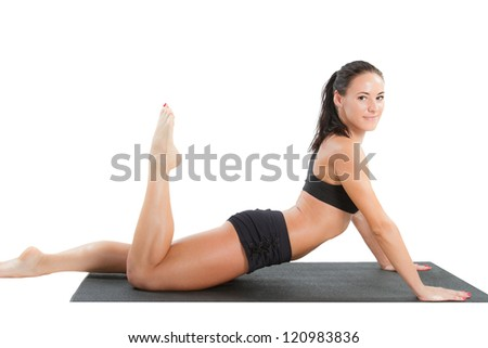 Sexy young yoga woman doing yogic exercise on isolated white background - stock photo