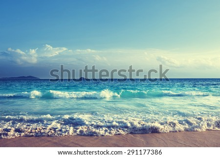 seychelles beach in sunset time - stock photo
