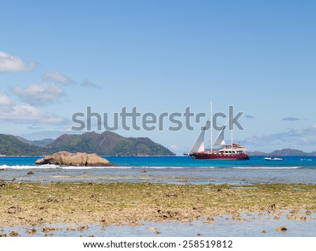 Seychelles - November 6, 2014: Most beautiful sailing yacht sailing along the Seychelles in the Indian Ocean November 6, 2014, Seychelles - stock photo