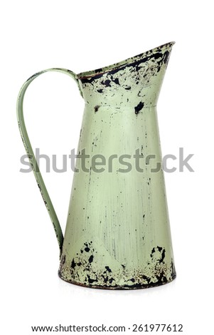 Shabby chic retro metal jug isolated on white.   - stock photo