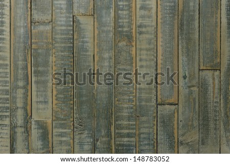 Shabby chic wooden table, green, yellow background, copy space - stock photo
