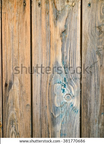 Shabby wooden planks with remains of paint, closeup - stock photo