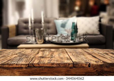 shabby wooden table sofa and interior of home  - stock photo